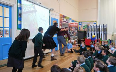 Author Stuart Reid brings 'Gorgeous George' to St Joseph's Juniors